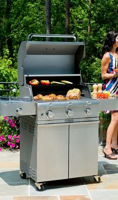 The Saber 3-burner Liquid Propane Grill with Cast Stainless Steel Lid uses a proprietary infrared cooking system that keeps meat naturally moist and tender, even when cooked to well-done. 3 Burner Gas Grill, Outdoor Oven, Outdoor Restaurant, Grill Accessories, Grill Master, Bbq Party, Backyard Bbq, Cooking Time, Wine Recipes