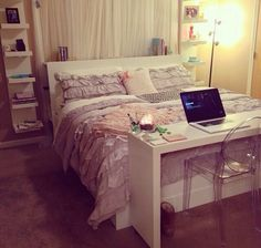 Simple IKEA desk at end of bed.