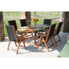 International Caravan Royal Tahiti Segovia Outdoor Wood Patio Dining Set by Intl. Caravan/Golden Needle. $1549.99. Dine like royalty on your own patio with the Royal Tahiti Segovia Outdoor Wood Patio Dining Set. This versatile and attractive patio dining set includes a dining table with six matching chairs, as well as a Lazy Susan rotating dining server. Each chair includes armrests for added comfort, and complements the table well with the black color on the seat and ...