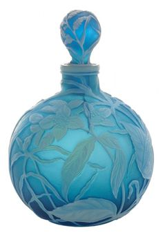 Thomas Webb & Sons Cameo Glass : Perfume Bottle English, late 19th century, opal with slight bluish tint over blue ground, blanketed by finely carved flowers, leaves and wheat, rare cameo stopper carved en suite,