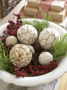 Scour crafts and home stores for woodlandlike spheres to display with seasonal gatherings. #holiday #decorations #christmas #diy