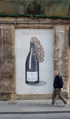 Street Art with champagne bottle by Escif in Valencia, Spain. Our tips for things to do in Valencia: http://www.europealacarte.co.uk/blog/2013/01/17/what-to-do-valencia/