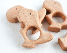Wooden T-Rex teether Each peace is hand cut, sanded satin smooth, finished with organic food grade flax seed oil. Dimensions: x x / x x Hole size: / Material: solid beech wood MADE IN UKRAINE Note: There might be a slight difference in the Handmade Wooden Toys, Wooden Baby Toys, Wood Toys, Baby Mobile, Dinosaur Toys, Kids Wood, Wood Patterns, Craft Sale, T Rex