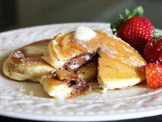 Chocolate-Stuffed Pancakes. forget the chocolate chips, just stuff 'em with it (: