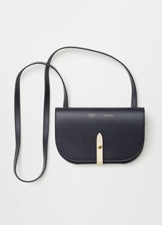 Celine - Summer 2016 STRAP CLUTCH ON STRAP IN NAVY PALMELATO AND SHINY CALFSKIN	 19,5 X 12,5 X 3 CM (8 X 5 X 1 IN) CALFSKIN AND SPLIT CALFSKIN LINING 106763AD7.07OC   $1.400 USD