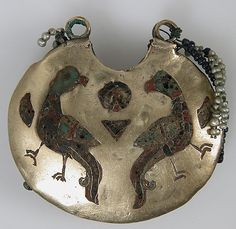 Metropolitan Museum of Art  One of a Pair of Temple Pendants, with Confronted Birds (front) and Human Heads (back)    Date:      11th–12th century  Geography:      Made in, Kiev  Culture:      Kievan Rus'  Medium:      Cloissonné enamels, electrum, pearls  Dimensions:      Overall: 1 1/2 x 1 5/8 x 7/16 in. (3.8 x 4.1 x 1.1 cm)  Classification:      Enamels-Cloisonné  Credit Line:      Gift of J. Pierpont Morgan, 1917  Accession Number:      17.190.704