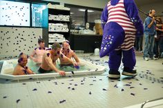 """Dinger Hot Tubbin'"" (2012): Dinger relaxes with some players after a hard game."