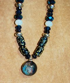 Close-up of handmade pendant and beads.