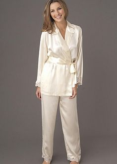 These just may be the perfect pajamas! These Julianna Rae silk pajamas are the perfect way to start or end your day in. They have a beautiful easy to wear wrap top and flat front with an elastic back and a convenient drawstring waist. The top also has security ties and a detachable sash. Don't miss the lace trim on the shirt and pant cuffs. #pajamas #pjs #silk #ladies #lingerie #white #luxury #juliannarae