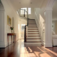 Anthony Wilder Design/Build, DC.Love the molding around doorway arch and up staircase!