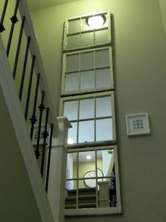 Old windows turned into dramatic stairway mirror. Love the idea for old windows Old Windows, Arched Windows, Windows And Doors, Mantle Headboard, Old Fireplace, Diy Casa, Decoration Originale, Old Doors, Stairways