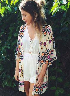 Multi colored geometric print chiffon kimono cardigan. Fabric: 100% Polyester Made in China