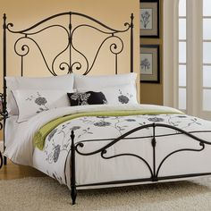 Anchor your guest room or master suite with this lovely wrought iron bed, showcasing scrolling details and finial accents.  Product: BedConstruction Mater...