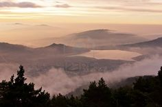 Dawn dress from the top of a mountain with a thick low fog that the people covers - Horizontal