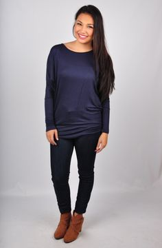 Tunic Top-- Minimal fashion at its' finest, this Tunic Top is the perfect foundation for a chic ensemble! A lightweight knit tunic with a scooping neck line. Only $22! Get it online at www.VirgoBoutique.com!