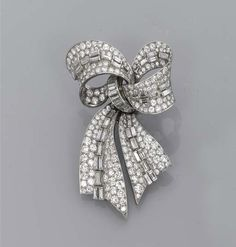 AN ATTRACTIVE ART DECO DIAMOND BOW BROOCH, BY BULGARI   The pavé-set diamond bow with baguette-cut diamond detail, mounted in platinum, circa 1935, 6.5 cm long, in fitted pink leather Bulgari case  Signed Bulgari