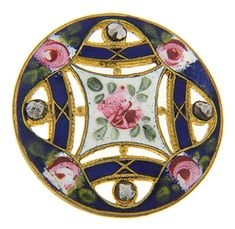 """Enamel, cut steel and brass are merged into a single whole on this antique button. Multicolored floral enamel is accented by cut steel spheres all on a brass foundation. The button measures 1 1/8"""" in diameter."""