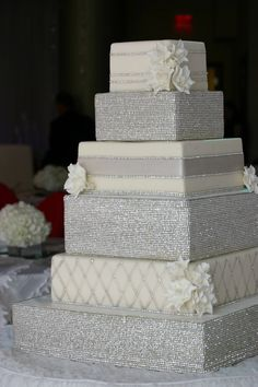 If your like glitz and sparkle, this cake is for you- adorned with both edible and non-edible elements that are easily remove able, this cake is certainly a show stopper.