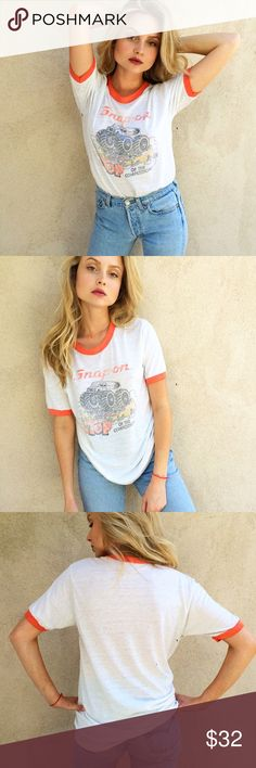 Vintage Monster Truck Ringer Tee My fav trend: the vintage ringer tee! This one is so super soft and has a very cool monster truck screen print. Labeled a M, but can fit XS/S as well. Distressed to perfection, vintage condition. Vintage Tops Tees - Short Sleeve