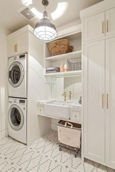 Bright white, gold hardware, marble counter, small spaces, European laundry