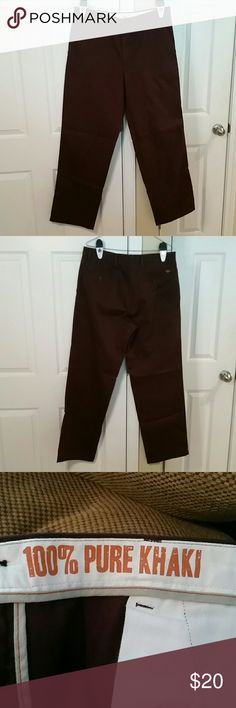 Dockers Classic Khakis Size 34x32 A pair of Dockers Classic Khakis Size 34x32.  Brand new without tags. Never been worn. Color is dark burgundy or wine. Please contact me if interested. Thanks! Dockers Pants Chinos & Khakis