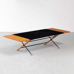 Greta Magnusson Grossman; Walnut, Steel and Plastic Laminate Drop-Leaf Coffee Table for Glenn of California, 1954.
