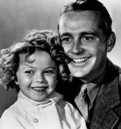 Shirley Temple and James Dunn in Bright Eyes, 1934.