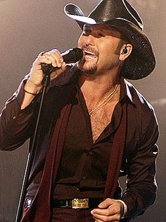 Tim McGraw! I rember my first favorite song was DANCING WHEN THE STARS GO BLUE WHEN I WAS THREE :))