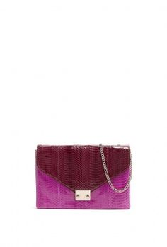 Hot Pink Watersnake Signature Lock Clutch with maxi skirt and black ankle boots