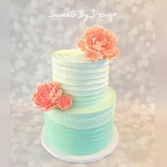 Mint ombre rustic buttercream cake with coral sugar peonies.