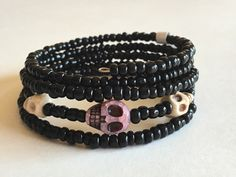 A personal favorite from my Etsy shop https://www.etsy.com/listing/291810055/purplepink-and-ivory-skull-bracelet