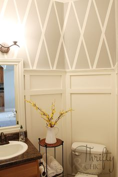 Bathroom makeover with diamond pattern wall using painter's tape and board and batten