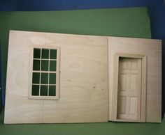 Make a simple dolls house scale roombox from Baltic Birch Plywood. A roombox can be finished with a front glass frame, or sized to fit as a group inside a bookcase or other piece of furniture to make a baby house.: Fit Windows and Doors In a Roombox Dollhouse Door, Dollhouse Furniture, Dollhouse Miniatures, Dollhouse Design, Mini Doll House, Barbie Doll House, Miniature Rooms, Miniature Houses, Dollhouse Tutorials