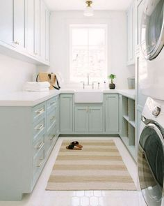 Blue green u-shaped laundry room boasts a beige striped rug placed on white hex floor tiles beneath a skylight. Blue green u-shaped laundry room boasts a beige striped rug placed on white hex floor tiles beneath a skylight. White Laundry Rooms, Mudroom Laundry Room, Laundry Room Organization, Laundry Room Design, White Rooms, Laundry Cabinets, Diy Cabinets, Mudrooms With Laundry, Laundry Room Floors