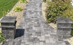 Bullnose-capped columns frame this Cobblestone walkway.