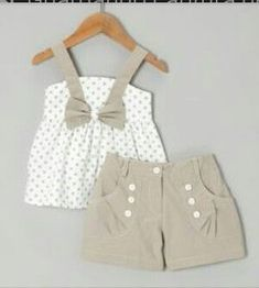 at this White Polka Dot Bow Top & Gray Shorts - Toddler & Girls on today!Look at this White Polka Dot Bow Top & Gray Shorts - Toddler & Girls on today! Little Girl Fashion, Toddler Fashion, Toddler Outfits, Kids Fashion, Outfits Niños, Kids Outfits, Fashion Outfits, Fashion Trends, Baby Kids