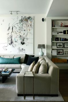 Contemporary & elegant living room with sectional sofa from interior designer Isabel Lopez