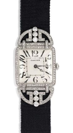 An exceptional Art Deco diamond watch with a square face and a grosgrain band, with a rose diamond deployant clasp. The watch and clasp are set with six full cut diamonds (atw. 0.42 ct.) and 190 rose cut diamonds, in platinum. European Watch & Clock movement. Cartier, France. Circa 1929