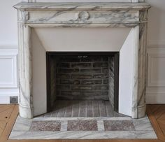 Small antique Louis XVI style fireplace with round corners in Arabescato marble