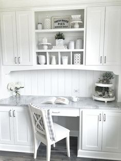 a vintage inspired white kitchen with a seamlessly built in desk with a marble countertops deskcabinet Kitchen Desk Areas, Kitchen Desks, New Kitchen Cabinets, Kitchen Countertops, Kitchen Furniture, Marble Countertops, Kitchen Office Nook, Kitchen Reno, Diy Kitchen
