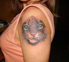 Ferocious Leopard Face Tattoo -  Great Tattoo Ideas and Pictures Enjoy! http://www.tattooideascentral.com/ferocious-leopard-face-tattoo/