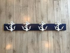Anchor coat or towel rack on reclaimed pallet wood. Hand painted.  Hanging hardware is included. However, I recommend anchoring this into the wall. It will allow you to hang heavy items.  Product dimensions: 34 x 3.5 inches  Anchors are 5 tall and made of cast iron  *All pallet wood is different. Some may have unique markings in the wood, holes from screws or nails. Every piece is different from the next.
