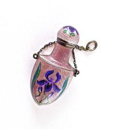 c1900 Art Nouveau chatelaine perfume bottle, screw top, light purple enamel on machined silver, floral motif. Silver mark. 2 1/8 in.