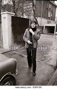 Paul McCartney of the Beatles about to get into his mini car December 1967 - Stock Image
