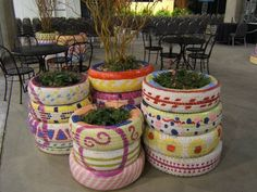 upcycle tires into planters, love the idea in this post to use them on school grounds to add some color & get children interested in gardening