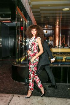 Zendaya slayed in a floral jumpsuit and voluminous natural hair while arriving at the Met Gala after party.