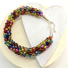 Beaded Bracelet Rainbow Seed Beads Kumihimo by WildBeadWoman