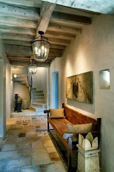Love this entryway from Houzz.  Look at the lighting and tile!  The space feels warm, and larger than it actually is.