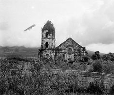 May 14, 1934: Remains of Cagsawa church in Albay province, Southeastern Luzon, Philippines. Source: John Tewell via Flickr/Photographer: Robert Larimore Pendleton (1890-1957).