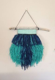 Hey, I found this really awesome Etsy listing at https://www.etsy.com/uk/listing/523830507/blue-green-shaggy-woven-wall-hanging